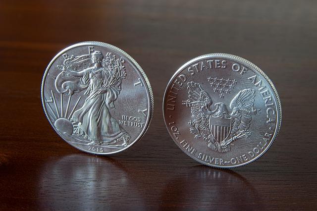 2 stříbrné americké mince.jpg